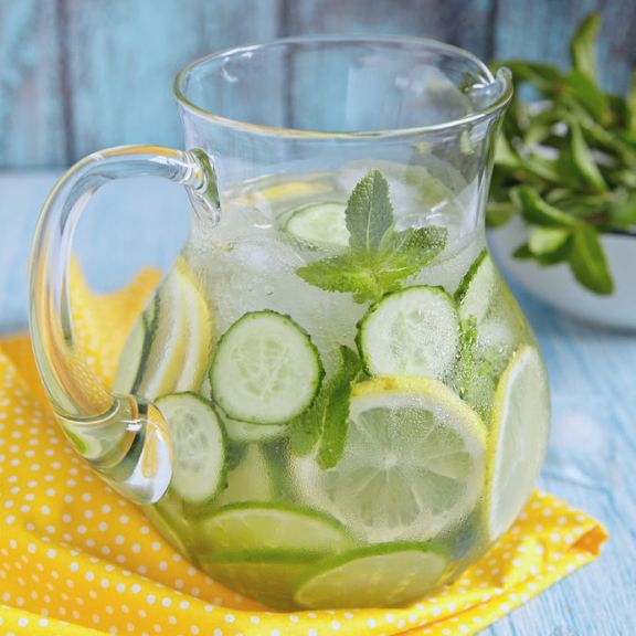 40546698 - fruit water with lemon, lime, cucumber and mint in glass pitcher