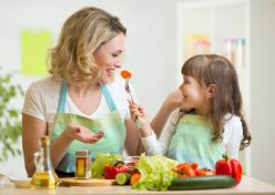 36834630 - kid and mother eating healthy food vegetables